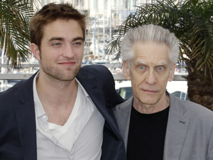 Robert Pattinson and director David Cronenberg pose during a photo call for Cosmopolis at the 65th international Cannes Film Festival