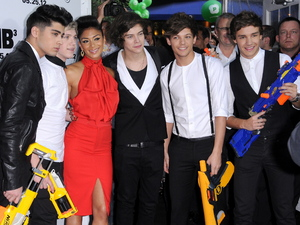 One Direction are pictured with Nicole Scherzinger at the Men in Black III premiere held at the Ziegfeld Theater in New York