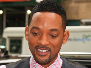 Will Smith signs autographs as he is mobbed by fans when leaving his hotel in Midtown Manhattan, New York