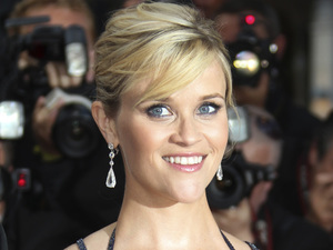 Actress Reese WItherspoon poses for photographers on the red carpet for the screening of 'Mud' at the 65th International Cannes Film Festival