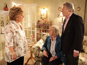 After seeing a picture of Dennis with Norma, a furious Rita charges round and catches Dennis with Norma