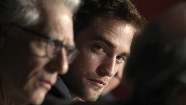 Robert Pattinson listens to questions during a press conference for Cosmopolis at the 65th international Cannes Film Festival
