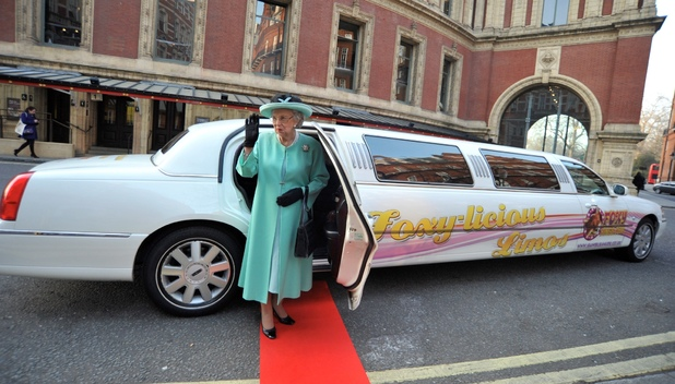 Queen lookalike Mary Reynolds waves from her Foxy Bingo limo