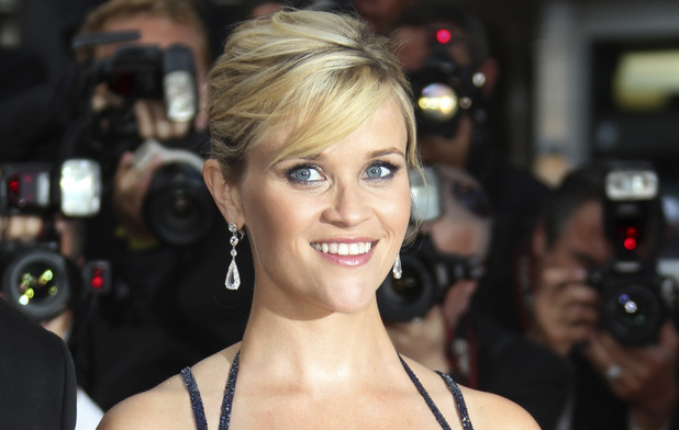 Actress Reese WItherspoon poses for photographers on the red carpet for the screening of &#39;Mud&#39; at the 65th International Cannes Film Festival