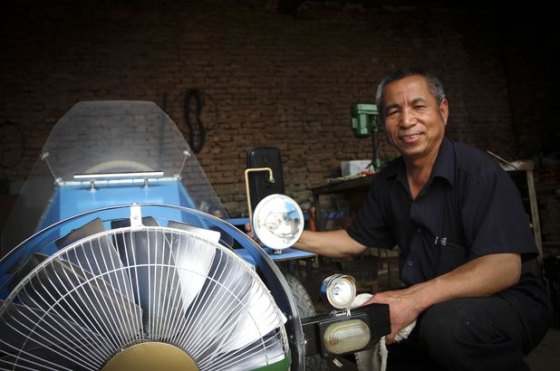 Tang Zhengping with his 'wind-powered' car, Beijing, China