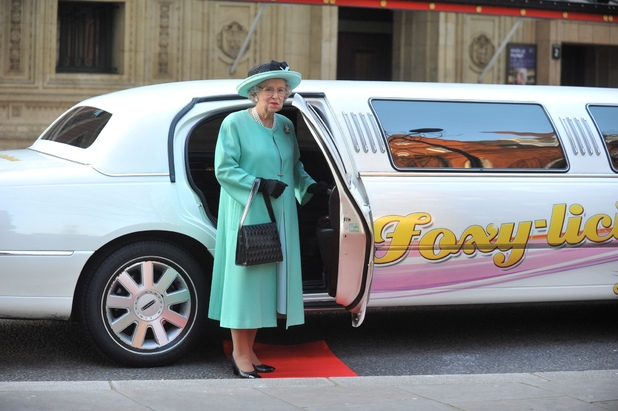Queen lookalike Mary Reynolds stands near her Foxy Bingo limo