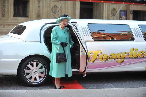 Queen lookalike Mary Reynolds stands near her Foxy Bingo limo