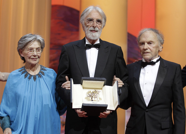 Director Michael Haneke poses with actors Emmanuelle Riva, left, and Jean-Louis Trintignant, right, after receiving the Palme d&#39;Or during the awards ceremony at the 65th international film festival, in Cannes