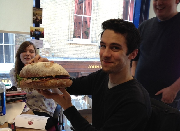 Morgan Jeffery eats a massive meat sandwich