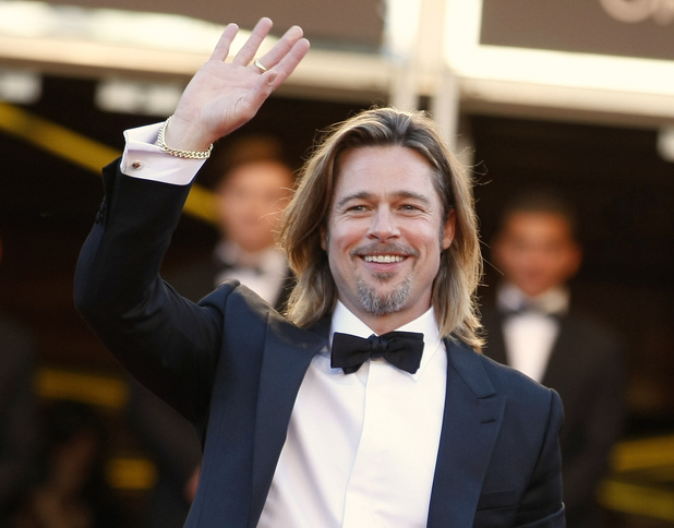 Brad Pitt waves as he arrives for the screening of Killing Them Softly at the 65th international Cannes Film Festival