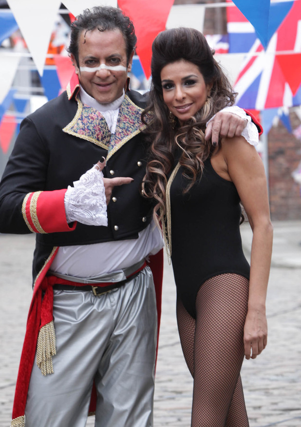 Dev dresses up as Adam Ant while Sunita dresses up as Beyonce on their coconut shy