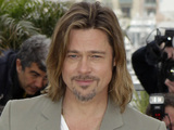 Brad Pitt poses during a photo call for Killing Them Softly at the 65th International Cannes Film Festival