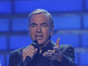 Maths teacher charged £2.6k to download a Neil Diamond record due to roaming charges.