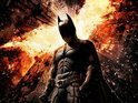 Christian Bale's Batman stands tall as the fire rises in Gotham City.