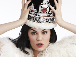 Jessie J wears a fur coat and a crown