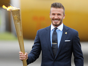 David Beckham with the Olympic torch during the ceremony to mark the arrival of the Olympic flame, at RNAS Culdrose, Cornwall.