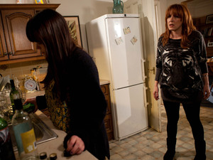 Martha catches Lacey pouring her booze down the sink.