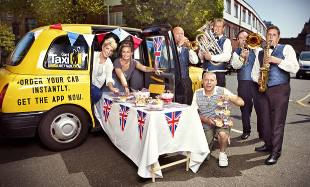 Colin 'The Cabbie' Sinclaire and a brass band at his black cab Diamond Jubilee street party