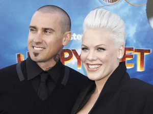 "Singer / voice recording artist Alecia Beth Moore aka Pink and husband Carey Hart arrive at the World Premiere of ""Happy Feet Two"" at Grauman's Chinese Theatre. Los Angeles, California"