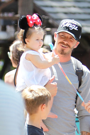 David Beckham, Harper Beckham , Beckham family on a day out to Disneyland. Los Angeles