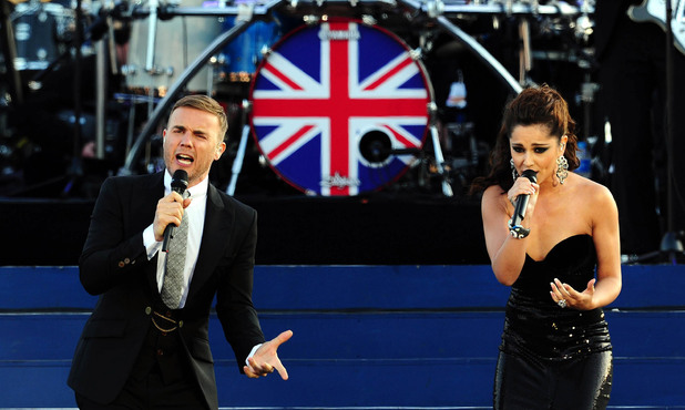 Gary Barlow and Cheryl Cole on stage outside Buckingham Palace during the Diamond Jubilee Concert.