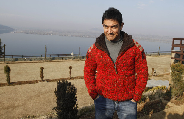 Bollywood actor Aamir Khan poses for a photograph outside his hotel in Srinagar, India, Thursday, Feb. 9, 2012.