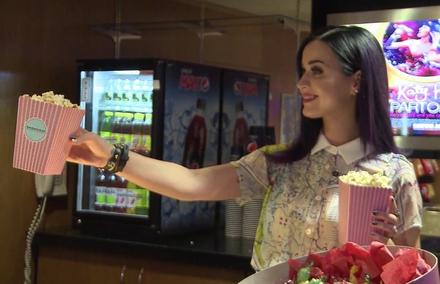 Katy Perry hands out popcorn at 'Part Of Me 3D' screening.