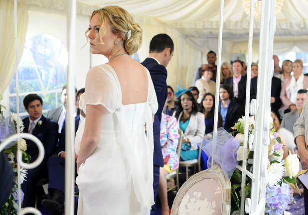 Janine is bewildered as Michael takes her back down the aisle.
