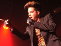 Adam Lambert performs duet with Cyndi Lauper at a New York benefit show.