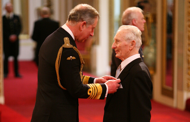 Mr. Arthur Gilbert from Burnham-On Sea is made an MBE by the Prince of Wales at Buckingham Palace
