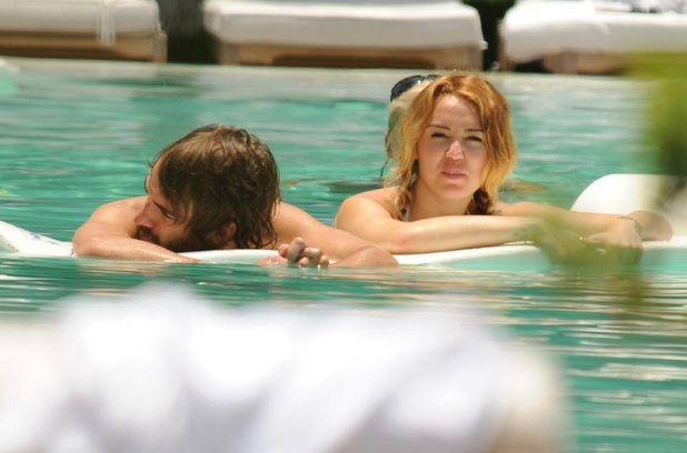 Miley Cyrus and Cheyne Thomas spend some time relaxing at the pool together Miami, Florida