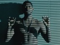 The singer gets topless for his latest music video.