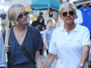 Ellen DeGeneres and Portia De Rossi take a walk with friends during their holiday in Portofino Portofino, Italy