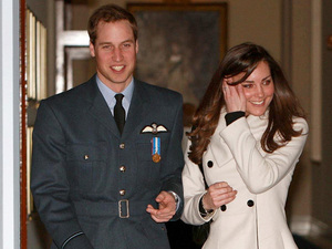 Prince William and his girlfriend Kate Middleton walk in RAF Cranwell, Lincolnshire after William received his RAF wings from his father the Prince of Wales. After more than 12 weeks training, the young royal became the fourth successive generation of the monarchy to become an RAF pilot.