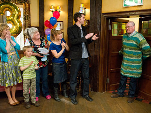 After various attempts to coax him into it, Paddy turns up at his suprise birthday in the Woolpack