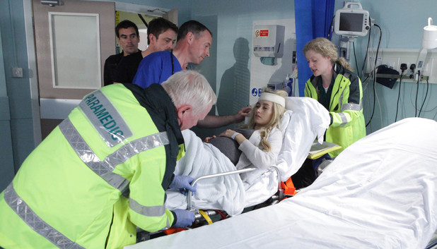After being injured, Debbie is rushed to hospital by paramedics