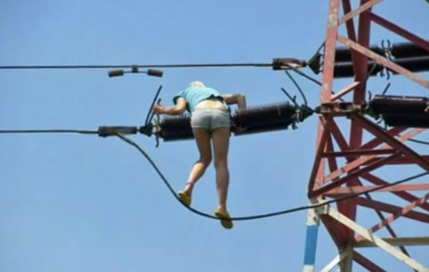 Woman climbing a pylon