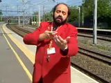 Luciano Pavarotti impersonator sings to rail commuters