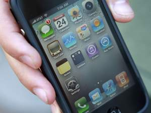 Daniel Rudofsky, 21, holds his new iPhone after standing in line outside the Apple Store in the Georgetown neighborhood of Washington, on Thursday, June 24, 2010