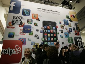 A poster touting apps available for the Apple&#39;s iPhone and iPod touch is seen at the Macworld Conference and Expo in San Francisco, Tuesday, Jan. 6, 2009