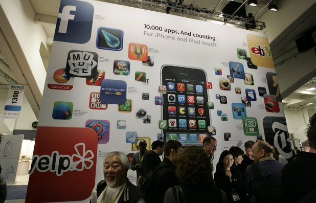 A poster touting apps available for the Apple's iPhone and iPod touch is seen at the Macworld Conference and Expo in San Francisco, Tuesday, Jan. 6, 2009