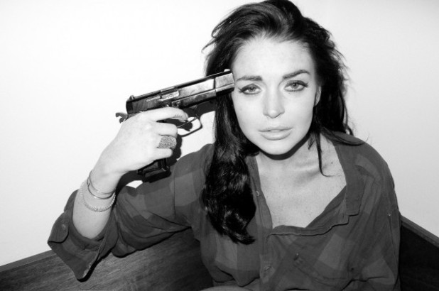 Lindsay Lohan poses with a gun for a Terry Richardson photo shoot