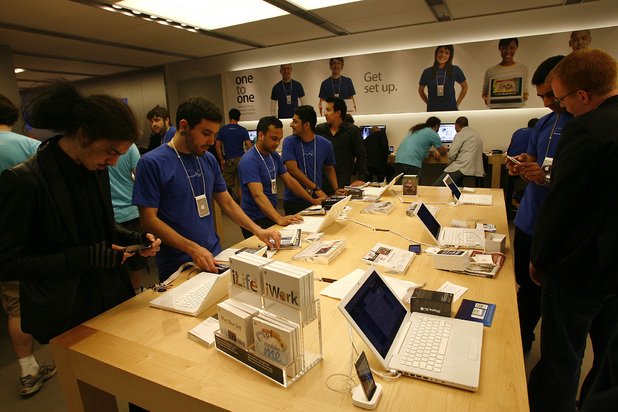 Staff help customers activate their new iPhone 3GS at an Apple store in London, Friday, June 19, 2009, as Apple launched the sale of the new iPhone in Britain