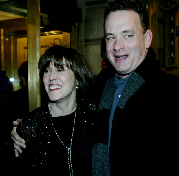 "Playwright and film director Nora Ephron, left, and actor Tom Hanks arrive at the Barrymore Theatre in New York, Thursday, Dec. 12, 2002, to attend the opening night of Ephron's Broadway play, ""Imaginary Friends,"" which portrays the battles between playwright Lillian Hellman and novelist Mary McCarthy."