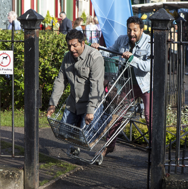 Masood jumps into the trolley as AJ pushes him down the street.