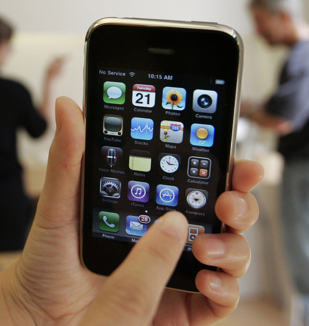 A customer displays an Apple iPhone 3GS