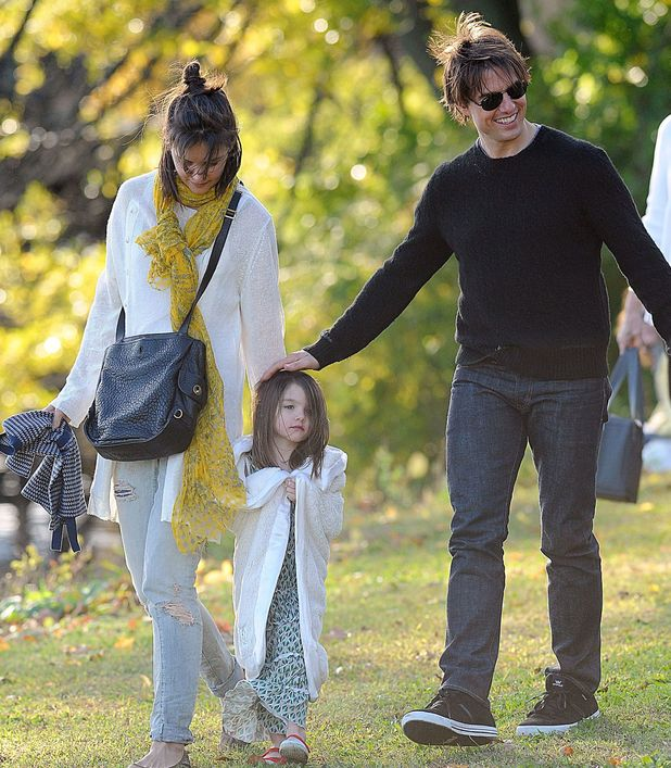 Tom Cruise and Katie Holmes with their daughter Suri in a park together in October 2009