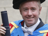 Filmmaker Mark Millar is pictured after receiving an honorary degree from Glasgow Caledonian University on Buchanan in Glasgow.