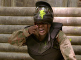 Kim gets involved in the paintball party.