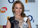 Kylie Minogue is awarded Silver Clef in recognition of her services to music.
